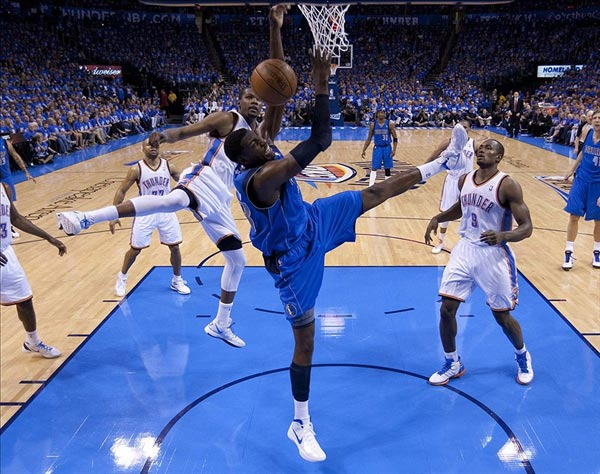 Dallas Mavericks center Ian Mahinmi shoots the ball against Oklahoma City Thunder small forward Kevin Durant
